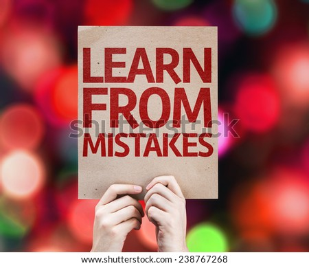 Learn From Mistakes card with colorful background with defocused lights - stock photo