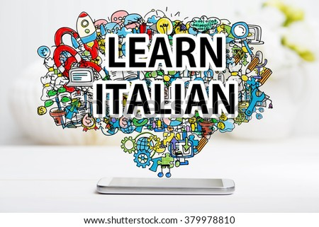 Learn Italian concept with smartphone on white table - stock photo