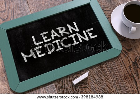 Learn Medicine Handwritten by white Chalk on a Blackboard. Composition with Small Blue Chalkboard and Cup of Coffee. Top View. 3D Render. - stock photo
