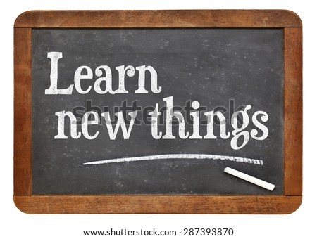 Learn new things - motivational text on an isolated  vintage slate blackboard - stock photo