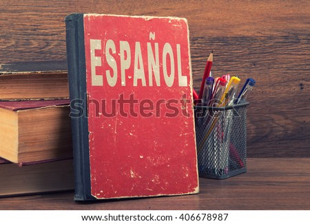 learn spanish concept. book on a wooden background