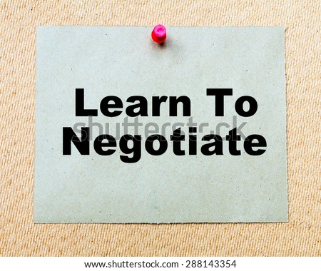 Learn To Negotiate written on paper note pinned with red thumbtack on wooden board. Business conceptual Image - stock photo