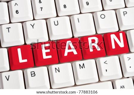 Learn word on white keyboard - stock photo