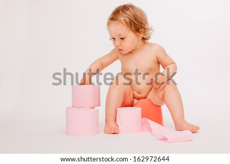 learning by doing baby on toilette - stock photo