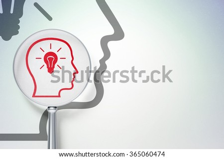 Learning concept:  Head With Lightbulb with optical glass on digital background - stock photo