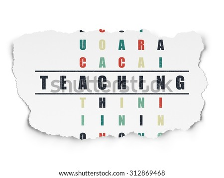 Learning concept: Painted black word Teaching in solving Crossword Puzzle on Torn Paper background - stock photo