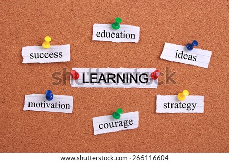 Learning concept paper words are pinned on cork. - stock photo