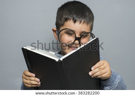learning, dark-haired young student reading a funny book, reading and learning