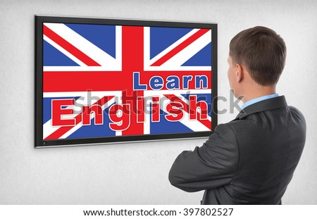 Learning english concept. Business man looking on a monitor screen