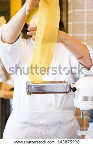 Learning how to make fresh spaghetti from scratch. - stock photo