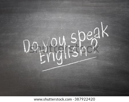 Learning language concept on a blackboard with the words Do you speak English? - stock photo