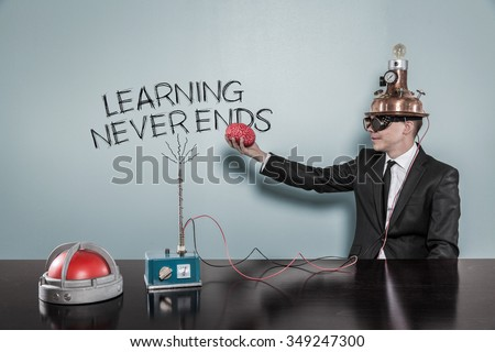 Learning never ends concept with businessman holding brain at hand in office - stock photo