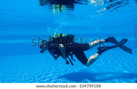 Learning to Scuba Dive in a Swimming Pool - stock photo