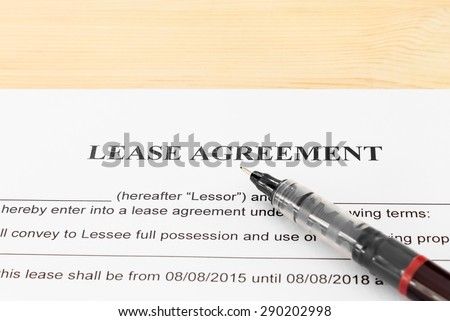 Lease Agreement Contract Document and Pen Horizontal View on Wood Table. Legal document for business event - stock photo