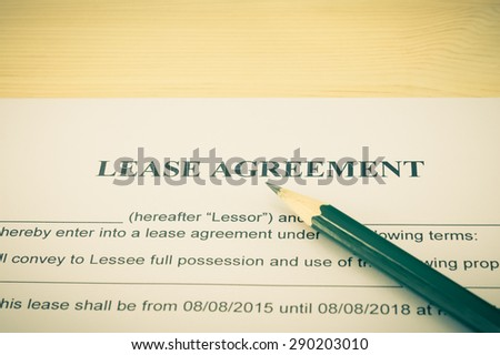 Lease Agreement Contract Document and Pencil Horizontal View on Wood Table in Vintage Style. Legal document for business event - stock photo