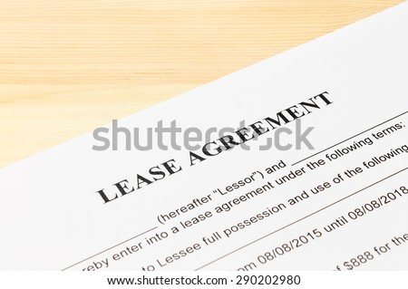 Lease Agreement Contract Document on Wood Table. Legal document for business event - stock photo