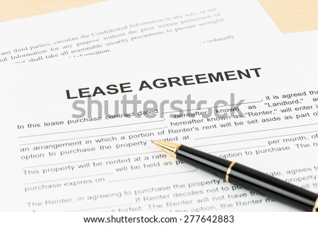 Lease agreement with pen; document is mock-up