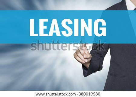Leasing word on virtual screen touch by business woman cyan sky tab - stock photo