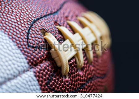 Leather American Football on Black background