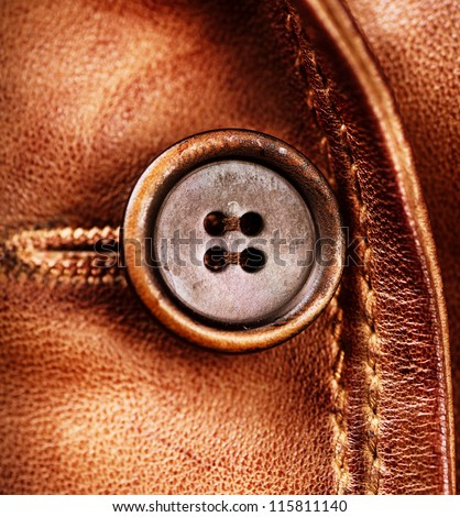 Leather and Button background. Genuine Leather Jacket Detail closeup - stock photo