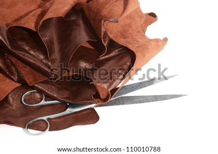 Leather and scissors - stock photo