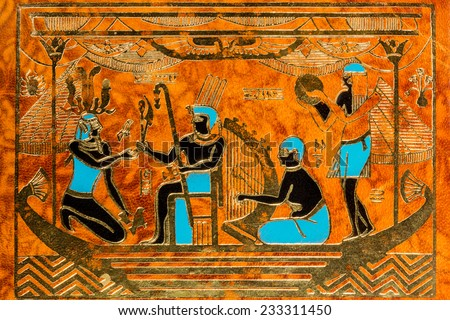 Leather background with ornament Egyptian Pharaoh with musicians - stock photo