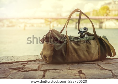 Leather bag on the stone ground, extreme camera on the top