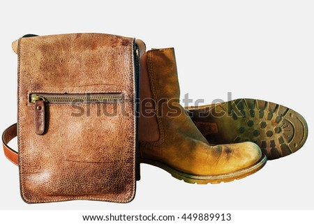 Leather bags and shoes on a white background.