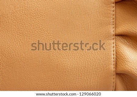 Leather beige background with the frill close-up