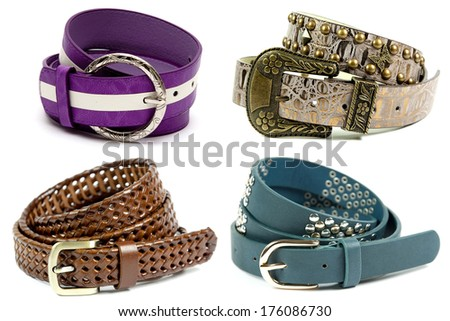 Leather belt of various color on white background. - stock photo