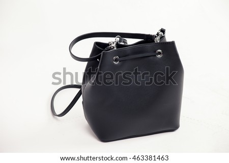 Leather black bag on a white background