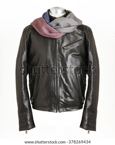 leather black jacket with a scarf on a shape on a mannequin doll - stock photo