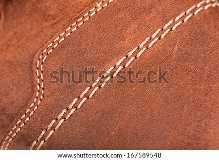Leather boot with stitches background - stock photo