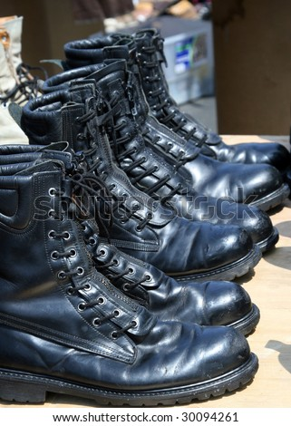 leather boots in the sun - stock photo