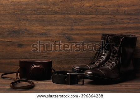 Leather boots on wooden surface