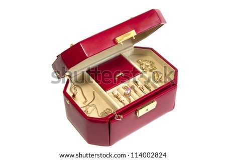 Leather box with gold jewelry isolated on white - stock photo