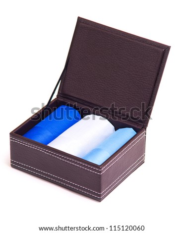 Leather box with textile handkerchiefs isolated on white
