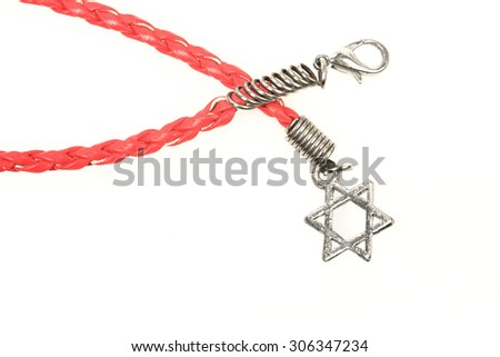 Leather bracelet with a silver Star of David isolated on white background - stock photo