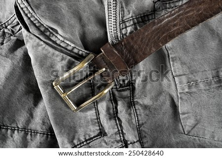 Leather brown belt on gray trousers  - stock photo