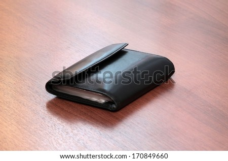 leather cards holder on a wooden background  - stock photo
