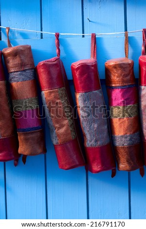 Leather colorful wallet - souvenirs from Morocco at medina of Chefchaouen. - stock photo