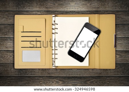 leather cover notebook and smartphone with clipping path screen desk top - stock photo