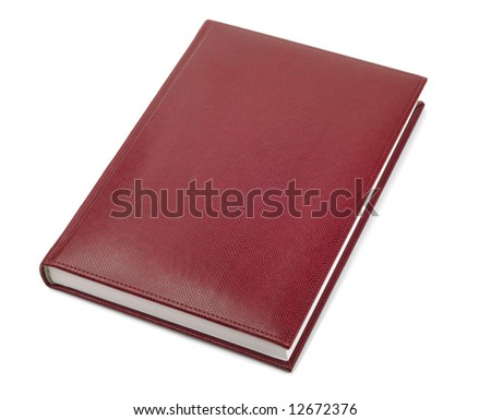 Leather covered book isolated with clipping path over white