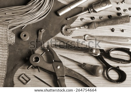 Leather craft tools and buckles  - toned image - stock photo