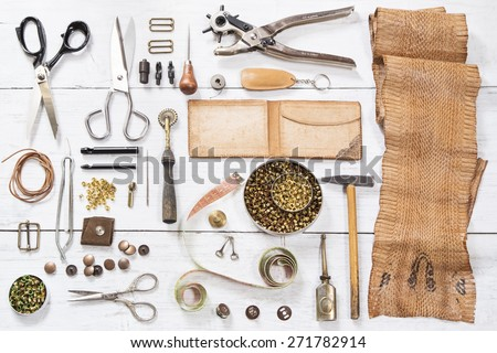 Leather craft tools and the snake skin - stock photo