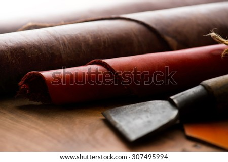 Leather craft. Work table of leathersmith. shallow depth of field. - stock photo