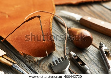 Leather crafting DIY tools still life  - stock photo
