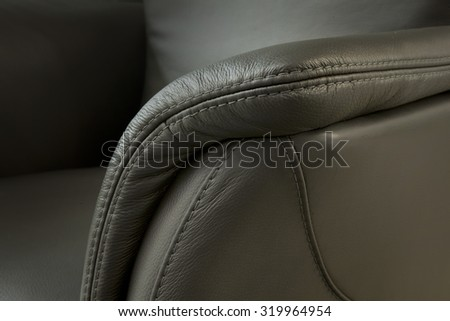 leather detail - upholstered furniture - stock photo