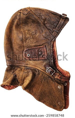 leather dirty vintage helmet over white background - stock photo