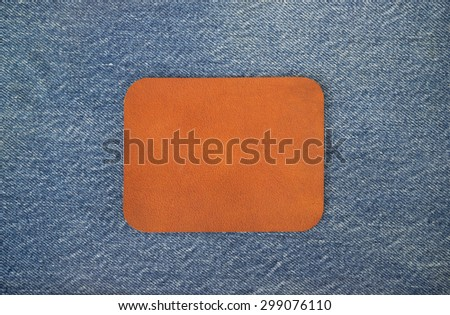 Leather empty on Jeans background - stock photo